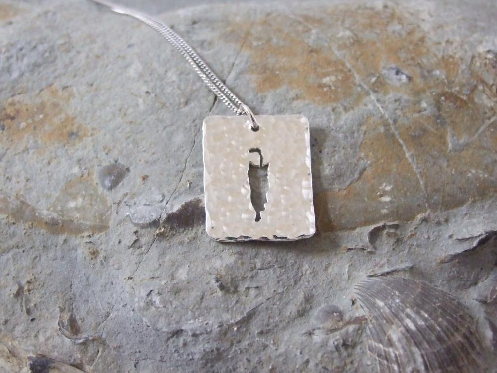 Stalking cat pendant: A cat stalks its prey on a background of textured sterling silver.