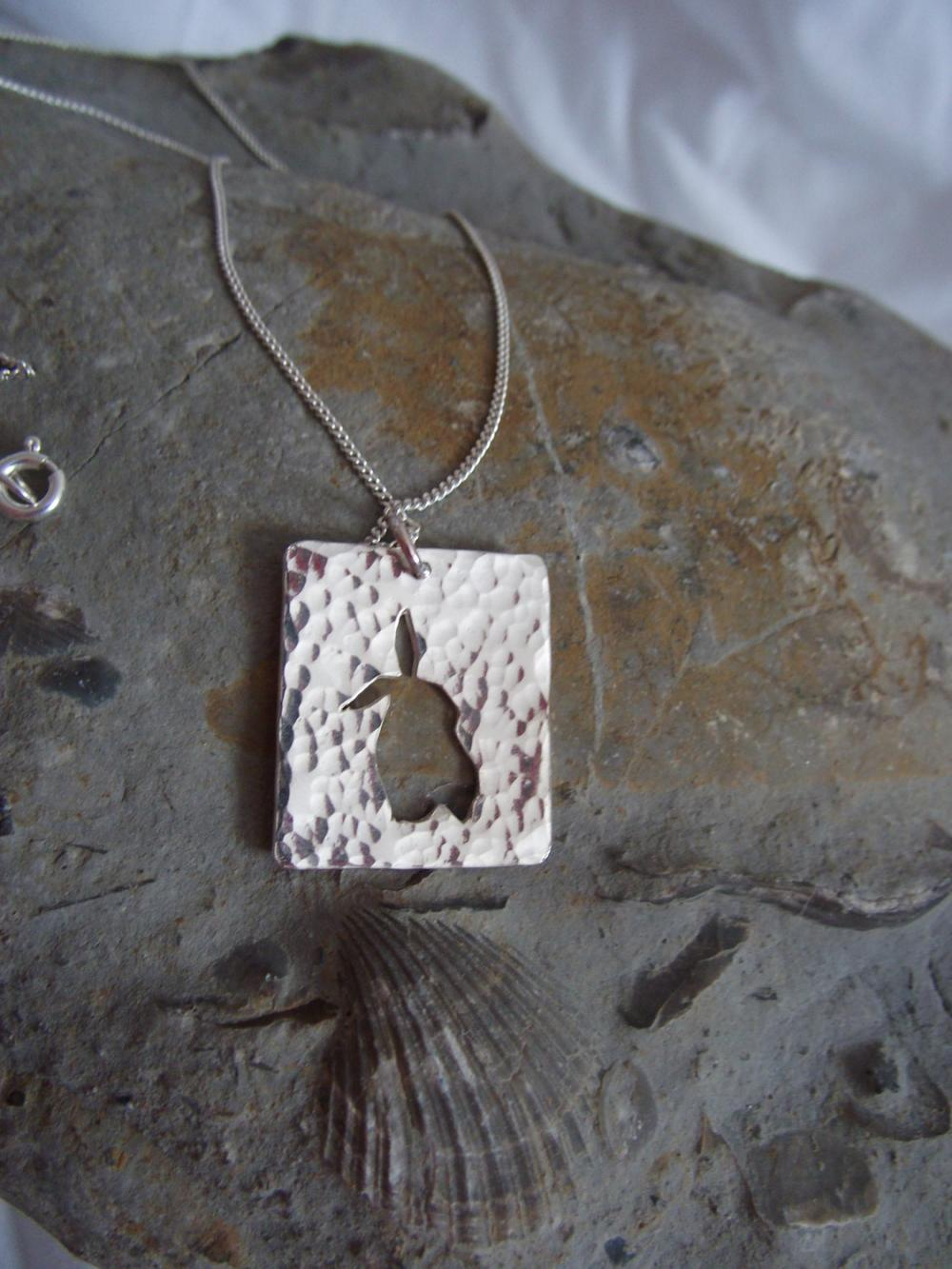 Silver rabbit pendant : A Curious bunny is listening to the world around her, on a background of hammered sterling silver.