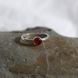 Silver Amber Ring: A beautiful sterling silver ring with a bezel set Amber stone.