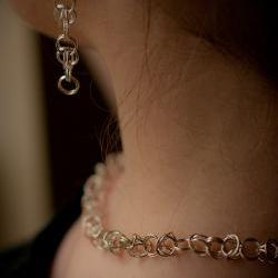 Clip-on Silver earrings: A pair of sterling silver byzantine chain maile earrings with each link soldered.